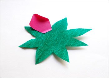 Green crepe paper sepal and pink petal