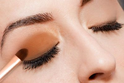 Apply darker on the lower half of the eyelid