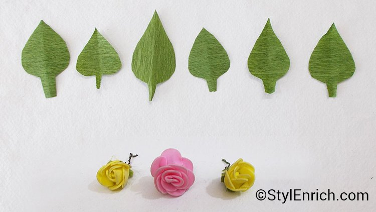 crepe paper leaves and plastic flowers