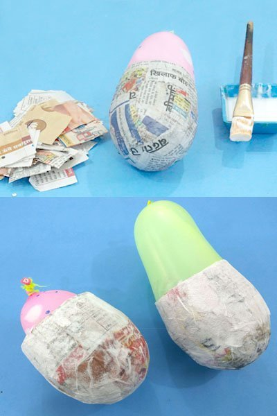 Balloons half covered with Newspaper