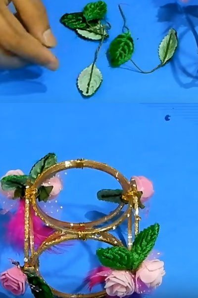 Take some artificial leaves and stick on the bangles craft structure