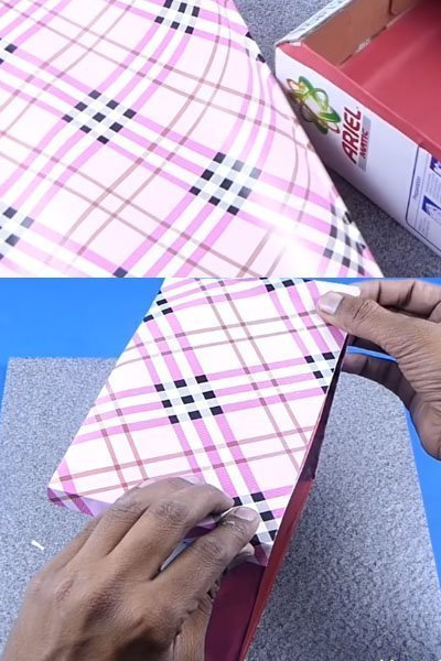 Cover the outer surface of the cardboard box with printed sheet