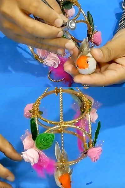 Fix some artificial birds on the wind chime craft structure